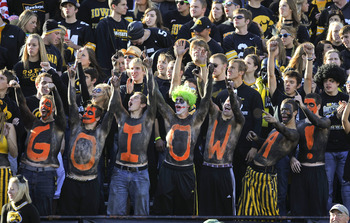 IOWA CITY, IA - OCTOBER 30: University of Iowa fans wearing Halloween paint cheer on their team during play again the Michigan State Spartans at Kinnick Stadium on October 30, 2010 in Iowa City, Iowa. Iowa won 37-6 over Michigan State. (Photo by David Pur