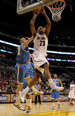 LOS ANGELES, CA - MARCH 11:  Derrick Williams #23 of the Arizona Wildcats drives to the basket past Brendan Lane #21 of the UCLA Bruins in the second half during the Quarterfinals of the Pac-10 Basketball Tournament at Staples Center on March 11, 2010 in
