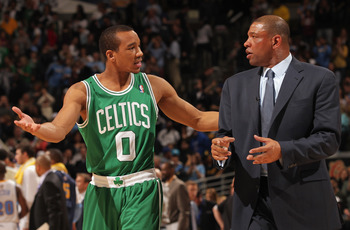 DENVER, CO - FEBRUARY 24:  Avery Bradley #0 and head coach Doc Rivers of the Boston Celtics talk as they leave the court after facing the Denver Nuggets during NBA action at the Pepsi Center on February 24, 2011 in Denver, Colorado. The Nuggets defeated t