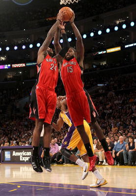 LOS ANGELES, CA - NOVEMBER 05:  Amir Johnson #15 and Sonny Weems #24 of  the Toronto Raptors go up for a rebound against the Los Angeles Lakers at Staples Center on November 5, 2010 in Los Angeles, California.  The Lakers won 108-102.   NOTE TO USER: User