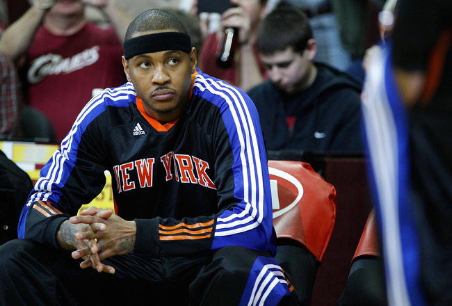 CLEVELAND - FEBRUARY 25:  Carmelo Anthony #7 of the New York Knicks sits on the bench prior to introductions before the game against the Cleveland Cavalierson February 25, 2011 at Quicken Loans Arena in Cleveland, Ohio. NOTE TO USER: User expressly acknow