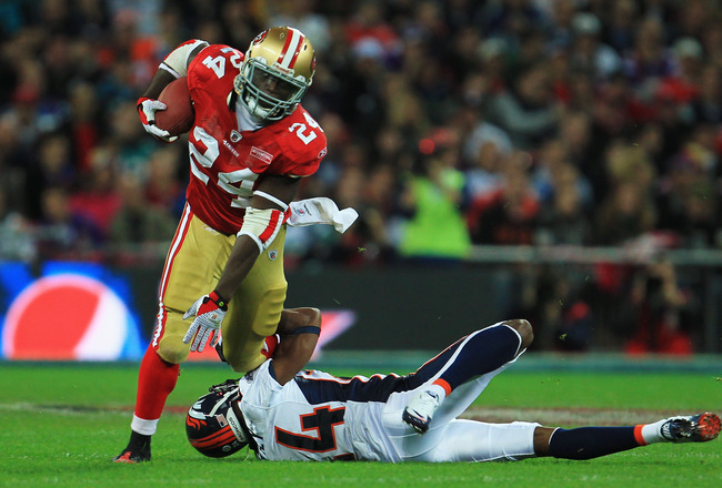 LONDON, ENGLAND - OCTOBER 31:  Anthony Dixon #24 of San Francisco 49ers is tackled by Champ Bailey #24 of Denver Broncos during the NFL International Series match between Denver Broncos and San Francisco 49ers at Wembley Stadium on October 31, 2010 in Lon