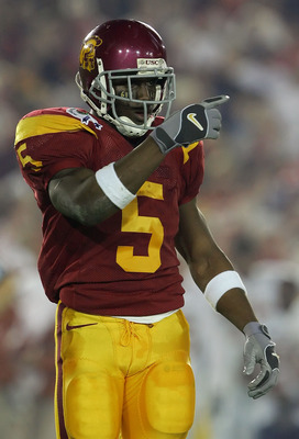 PASADENA, CA - JANUARY 04:  Reggie Bush #5 of the USC Trojans points to the sidelines during the first half of the BCS National Championship Rose Bowl Game against the Texas Longhorns at the Rose Bowl on January 4, 2006 in Pasadena, California.  (Photo by