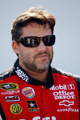 DAYTONA BEACH, FL - FEBRUARY 18:  Tony Stewart, driver of the #14 Mobil 1/Office Depot Chevrolet, looks on in the garage area during practice for the NASCAR Sprint Cup Series Daytona 500 at Daytona International Speedway on February 18, 2011 in Daytona Be