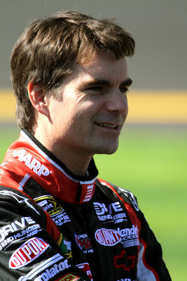 DAYTONA BEACH, FL - FEBRUARY 13:  Jeff Gordon, driver of the #24 Drive to End Hunger Chevrolet, stands on the grid during qualifying for the NASCAR Sprint Cup Series Daytona 500 at Daytona International Speedway on February 13, 2011 in Daytona Beach, Flor