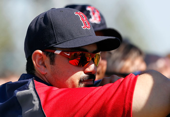 FORT MYERS, FL - FEBRUARY 19:  First baseman Adrian Gonzalez #28 of the Boston Red Sox watches batting practice during a Spring Training Workout Session at the Red Sox Player Development Complex on February 19, 2011 in Fort Myers, Florida.  (Photo by J. M