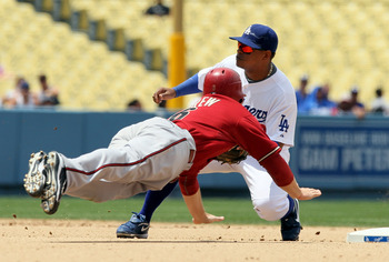 LOS ANGELES, CA - JUNE 02:  Stephen Drew #6 of the Arizona Diamondbacks is tagged out by Ronnie Belliard #3 of the Los Angeles Dodgers while trying to steal second base in the seventh inning at Dodger Stadium on June 2, 2010 in Los Angeles, California.  T