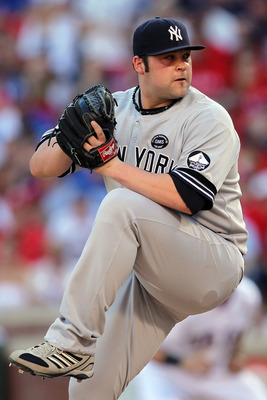 ARLINGTON, TX - OCTOBER 16:  Joba Chamberlain #62 of the New York Yankees throws a pitch against the Texas Rangers in Game Two of the ALCS during the 2010 MLB Playoffs at Rangers Ballpark in Arlington on October 16, 2010 in Arlington, Texas.  (Photo by St