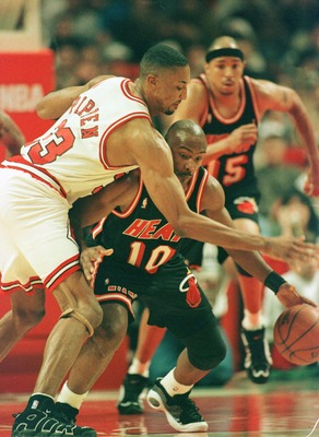 26 Apr 1996:  Point guard Tim Hardaway #10 of the Miami Heat dribbles up court while receiving defensive pressure by forward Scottie Pippen #33 of the Chicago Bulls during the Bulls first round playoff game against the Heat at the Ubited Center in Chicago