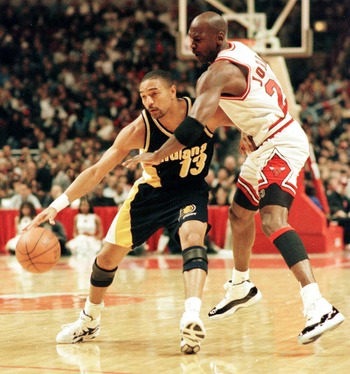 20 Apr 1996:  Point guard Mark Jackson of the Indiana Pacers fends off the defensive pressure applied by guard Michael Jordan of the Chicago bulls during the first quarter of the Bulls game against the Pacers at the United Center in Chicago, Illinois. Man