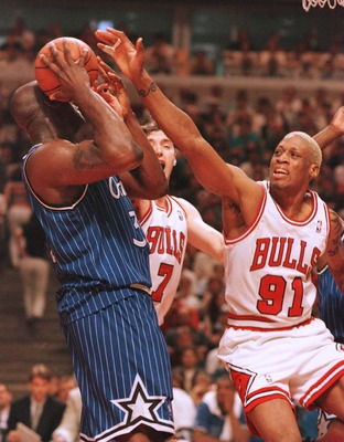 19 May 1996: Forward Dennis Rodman of the Chicago Bulls defends against center Shaquille O''Neal of the Orlando Magic during the third quarter of game one of the Eastern Conference Championships at the United Center in Chicago, Illinois. The Bulls went on
