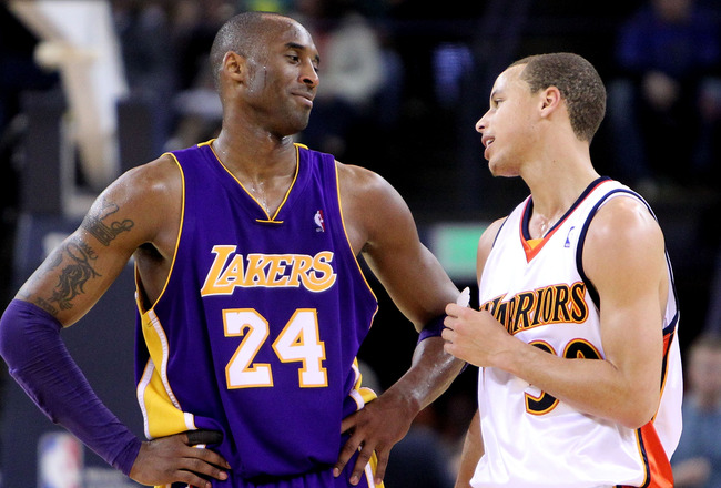 OAKLAND, CA - MARCH 15:  Kobe Bryant #24 of the Los Angeles Lakers jokes with Stephen Curry #30 of the Golden State Warriors during an NBA game at Oracle Arena on March 15, 2010 in Oakland, California. NOTE TO USER: User expressly acknowledges and agrees