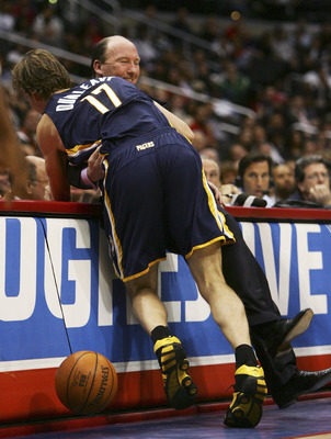 LOS ANGELES, CA - MARCH 03:  Mike Dunleavy Jr. #17 of the Indiana Pacers collides with father and Head Coach Mike Dunleavy of the Los Angeles Clippers during the second quarter at the Staples Center on March 3, 2007 in Los Angeles, California.  NOTE TO US