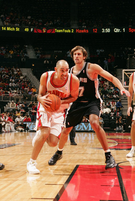 ATLANTA - NOVEMBER 13:  Jon Barry #20 of the Atlanta Hawks drives around Brent Barry #17 of the San Antonio Spurs during the game on November 13, 2004 at Philips Arena in Atlanta, Georgia.  The Spurs won 103-88.  NOTE TO USER: User expressly acknowledges