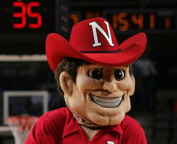 DALLAS - MARCH 9:  The mascot of the Nebraska Cornhuskers entertains fans during a break in game action against the Missouri Tigers in the first round of the Phillips 66 Big 12 Men's Basketball Championship Tournament at American Airlines Arena on March 9
