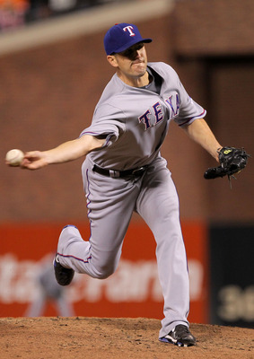 SAN FRANCISCO - OCTOBER 28:  Darren O'Day #56 of the Texas Rangers pitches in the eighth inning while taking on the San Francisco Giants in Game Two of the 2010 MLB World Series at AT&amp;T Park on October 28, 2010 in San Francisco, California.  (Photo by Dou