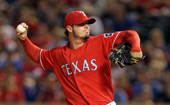 ARLINGTON, TX - OCTOBER 01:  Pitcher Mark Lowe #49 of the Texas Rangers thows against the Los Angeles Angels of Anaheim at Rangers Ballpark in Arlington on October 1, 2010 in Arlington, Texas.  (Photo by Ronald Martinez/Getty Images)