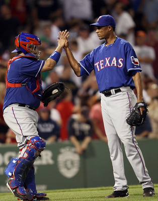 BOSTON - JULY 15:  Alexi Orgando #64 and Bengie Molina #11 of the Texas Rangers celebrate the win over the Boston Red Sox on July 15, 2010 at Fenway Park in Boston, Massachusetts. The Rangers defeated the Red Sox 7-2.  (Photo by Elsa/Getty Images)