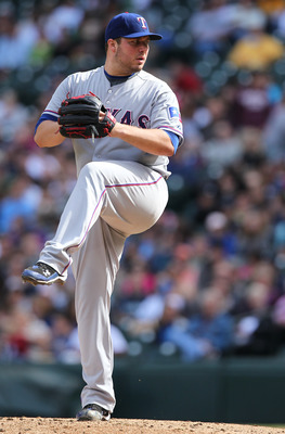 SEATTLE - SEPTEMBER 19:  Starting pitcher Tommy Hunter #35 of the Texas Rangers pitches against the Seattle Mariners at Safeco Field on September 19, 2010 in Seattle, Washington. The Mariners won 2-1. (Photo by Otto Greule Jr/Getty Images)