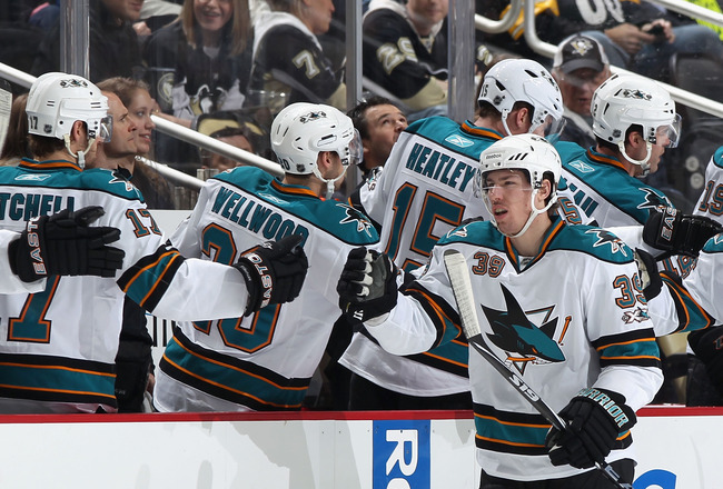 PITTSBURGH, PA - FEBRUARY 23:  Logan Couture #39 of the San Jose Sharks celebrates with teammates after scoring during the NHL game against the Pittsburgh Penguins at Consol Energy Center on February 23, 2011 in Pittsburgh, Pennsylvania. The Sharks defeat