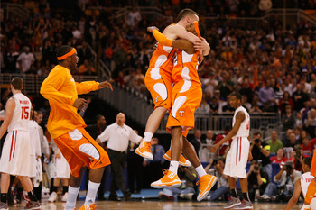 ST. LOUIS - MARCH 26: Steven Pearl #22 and Scotty Hopson #32 both of the Tennessee Volunteers celebrate their victory over the Ohio State Buckeyes during the midwest regional semifinal of the 2010 NCAA men's basketball tournament at the Edward Jones Dome