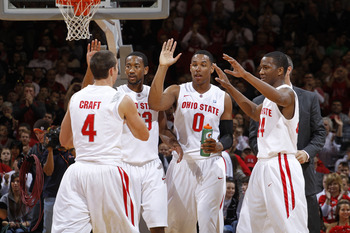 COLUMBUS, OH - NOVEMBER 26: William Buford #44, Jared Sullinger #0, David Lighty #23 and Aaron Craft #4 of the Ohio State Buckeyes celebrate after a basket before a timeout in the game against the Miami RedHawks at Value City Arena on November 26, 2010 in