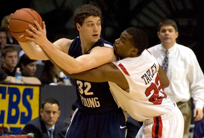 SAN DIEGO, CA - FEBRUARY 26:  Jimmer Fredette #32 of the Brigham Young Cougars looks to pass the ball against Chase Tapley #22 of the San Diego State Aztecs during the second half at Cox Arena on February 26, 2011 in San Diego, California. BYU beat SDSU 8