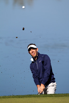 MARANA, AZ - FEBRUARY 24:  Charl Schwartzel of South Africa hits a shot on the green of the third hole during the second round of the Accenture Match Play Championship at the Ritz-Carlton Golf Club on February 24, 2011 in Marana, Arizona.  (Photo by Sam G