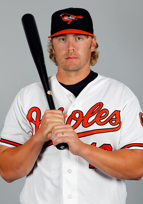 SARASOTA, FL - FEBRUARY 26:  Infielder Mark Reynolds #12 of the Baltimore Orioles poses for a photo during photo day at Ed Smith Stadium on February 26, 2011 in Sarasota, Florida.  (Photo by J. Meric/Getty Images)