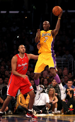 LOS ANGELES, CA - FEBRUARY 25:   Lamar Odom #7 of the Los Angeles Lakers jumps to control the ball against Brian Cook #34 of the Los Angeles Clippers at Staples Center on February 25, 2011 in Los Angeles, California. The Lakers won 108-95.  NOTE TO USER: