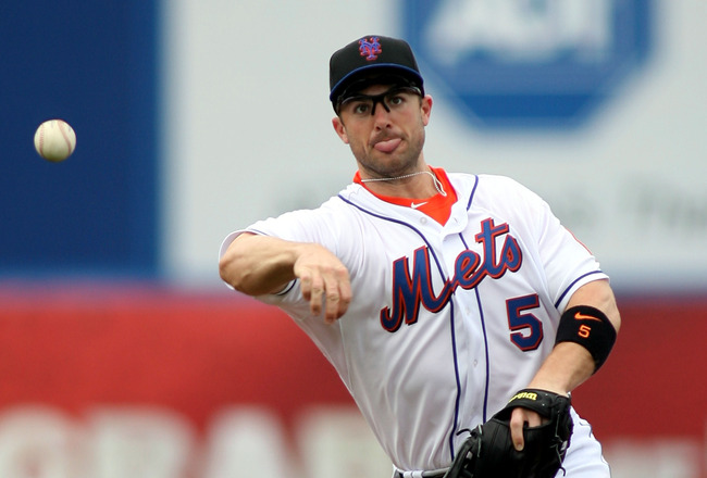 PORT ST. LUCIE, FL - FEBRUARY 26:  Third baseman David Wright #5 throws against the Atlanta Braves at Digital Domain Park on February 26, 2011 in Port St. Lucie, Florida.  (Photo by Marc Serota/Getty Images)