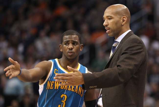 PHOENIX, AZ - JANUARY 30:  Chris Paul #3 of the New Orleans Hornets talks with head coach Monty Williams during the NBA game against the Phoenix Suns at US Airways Center on January 30, 2011 in Phoenix, Arizona. The Suns defeated the Hornets 104-102. NOTE