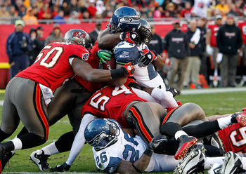 TAMPA, FL - DECEMBER 26: Running back Marshawn Lynch #24 of the Seattle Seahawks is stopped at the goal line by the Tampa Bay Buccaneers defense during the game at Raymond James Stadium on December 26, 2010 in Tampa, Florida. (Photo by J. Meric/Getty Imag