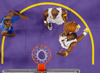 LOS ANGELES, CA - JUNE 7:  Kobe Bryant #24 of the Los Angeles Lakers dunks the ball as Rafer Alston #1 of the Orlando Magic looks on in Game Two of the 2009 NBA Finals at Staples Center on June 7, 2009 in Los Angeles, California. NOTE TO USER: User expres