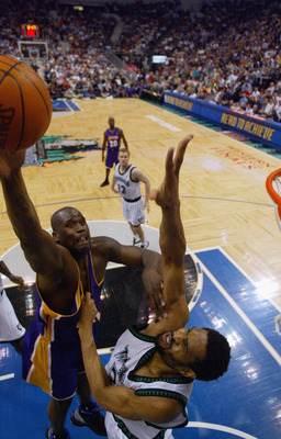 MINNEAPOLIS - MAY 29:  Shaquille O'Neal #34 of the Los Angeles Lakers shoots over Michael Olowokandi #34 of the Minnesota Timberwolves in Game five of the Western Conference Finals during the 2004 NBA Playoffs at Target Center on May 29, 2004 in Minneapol