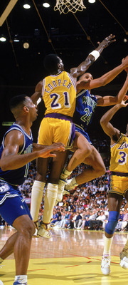 LOS ANGELES - 1990:  Pooh Richardson #24 of the Minnesota Timberwolves goes up for the shot against Michael Cooper #21 of the Los Angeles Lakers in a game at the Great Western Forum in Los Angeles, California during the 1989-1990 NBA season.  (Photo by Mi