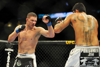 PHILADELPHIA - AUGUST 08:  (L-R)  Ricardo Almeida battles Kendall Grove during their middleweight bout at UFC 101: Declaration at the Wachovia Center on August 8, 2009 in Philadelphia, Pennsylvania.  Almeida defeated Grove by unanimous decision.  (Photo b