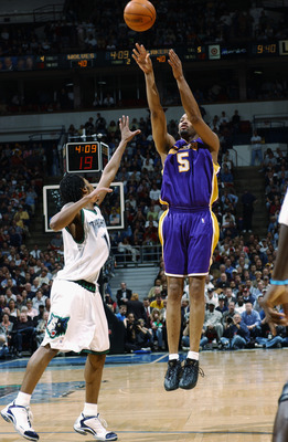 MINNEAPOLIS - APRIL 29:  Robert Horry #5 of the Los Angeles Lakers shoots over Troy Hudson #16 of the Minnesota Timberwolves in Game five of the Western Conference Quarterfinals during the 2003 NBA Playoffs at Target Center on April 29, 2003 in Minneapoli