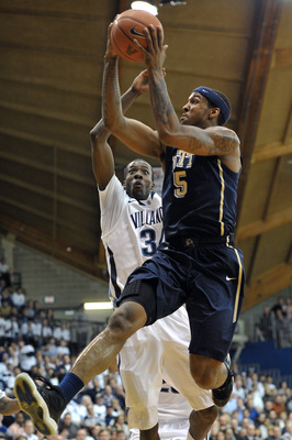 VILLANOVA, PA - FEBRUARY 12: Gilbert Brown #5 of the Pittsburgh Panthers lays up a shot past Isaiah Armwood #34 of the Villanova Wildcats at The Pavilion on February 12, 2011 in Villanova, Pennsylvania (Photo by Drew Hallowell/Getty Images)