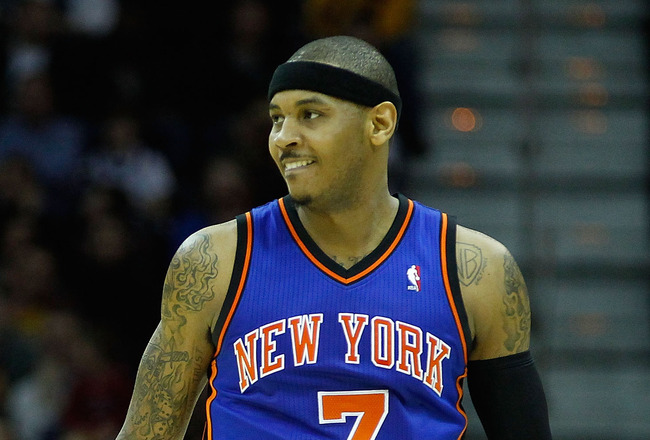 CLEVELAND - FEBRUARY 25:  Carmelo Anthony #7 of the New York Knicks stands on the court during the game against the Cleveland Cavaliers on February 25, 2011 at Quicken Loans Arena in Cleveland, Ohio. NOTE TO USER: User expressly acknowledges and agrees th