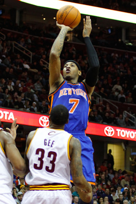 CLEVELAND - FEBRUARY 25:  Carmelo Anthony #7 of the New York Knicks attempts a shot over Alonzo Gee #33 of the Cleveland Cavaliers during the game on February 25, 2011 at Quicken Loans Arena in Cleveland, Ohio.  NOTE TO USER: User expressly acknowledges a