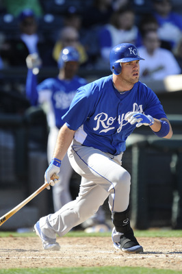 SURPISE, AZ - FEBRUARY 27: Mike Moustakas #8 of the Kansas City Royals bats during a spring training game against the Texas Rangers at Surprise Stadium on February 27, 2011 in Surprise, Arizona. (Photo by Rob Tringali/Getty Images)