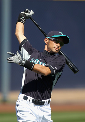 PEORIA, AZ - MARCH 12:  Ichiro Suzuki #51 of the Seattle Mariners warms up before the spring training game against the Oakland Athletics at Peoria Stadium on March 12, 2011 in Peoria, Arizona.  (Photo by Christian Petersen/Getty Images)