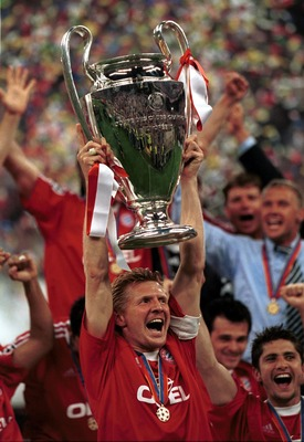 23 May 2001: Captain Stefan Effenberg of Bayern Muinch lifts the European Cup after the match between Valencia and Bayern Munich in the UEFA Champions League Final at the San Siro, Milan, Italy. Mandatory Credit: Stu Forster/ALLSPORT