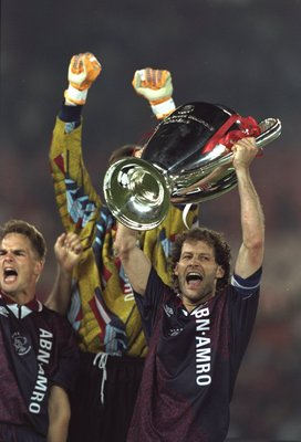 24 May 1995:  Danny Blind of Ajax raises the trophy in celebration after their victory in the European Cup Final against Milan in Vienna, Austria. Ajax won the match 1-0. \ Mandatory Credit: Clive  Brunskill/Allsport
