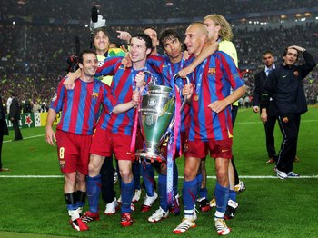 PARIS - MAY 17:  (L-R) Ludovic Giuly, Mark Van Bommel, Giovanni Van Bronckhorst and Henrik Larsson of Barcelona celebrate with the trophy after their team wins the UEFA Champions League Final between Arsenal and Barcelona at the Stade de France on May 17,