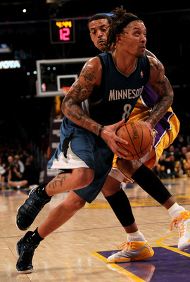 LOS ANGELES, CA - NOVEMBER 09:  Michael Beasley #8 of the Minnesota Timberwolves drives past Matt Barnes #9 of the Los Angeles Lakers at Staples Center on November 9, 2010 in Los Angeles, California. The Lakers won 99-94.   NOTE TO USER: User expressly ac