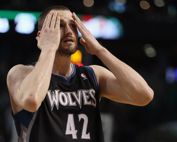 BOSTON, MA - JANUARY 03:  Kevin Love #42 of the Minnesota Timberwolves wipes his face in the fourth quarter against the Boston Celtics on January 3, 2011 at the TD Garden in Boston, Massachusetts. The Celtics defeated the Timberwolves 96-93. NOTE TO USER: