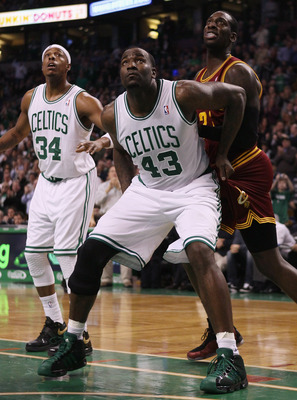 BOSTON, MA - JANUARY 25:  Kendrick Perkins #43  of the Boston Celtics blocks a shot as J.J. Hickson #21 of the of the Cleveland Cavaliers stands by on January 25, 2011 at the TD Garden in Boston, Massachusetts.   NOTE TO USER: User expressly acknowledges