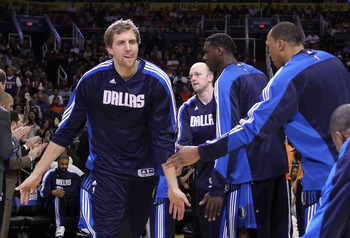 PHOENIX, AZ - FEBRUARY 17:  Dirk Nowitzki #41 of the Dallas Mavericks high fives teammates during introductions to the NBA game against the Phoenix Suns at US Airways Center on February 17, 2011 in Phoenix, Arizona.  NOTE TO USER: User expressly acknowled